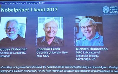 Portraits of the winners of the 2017 Nobel Prize in Chemistry are seen on a screen (L-R) Jacques Dubochet from Switzerland, Joachim Frank from the US and Richard Henderson from Britain on October 4, 2017 at the Royal Swedish Academy of Sciences in Stockholm, Sweden. (Jonathan Nackstrand/AFP)