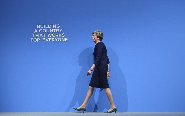 Britain's Prime Minister Theresa May takes the stage to deliver her speech on the final day of the Conservative Party annual conference at the Manchester Central Convention Centre in Manchester, northwest England, on October 4, 2017. (AFP PHOTO / Oli SCARFF)