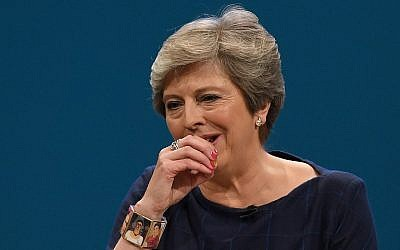 Britain's Prime Minister Theresa May coughs as she delivers a speech on the final day of the annual Conservative Party conference at the Manchester Central Convention Centre in Manchester, England, on October 4, 2017. (AFP Photo/Paul Ellis)
