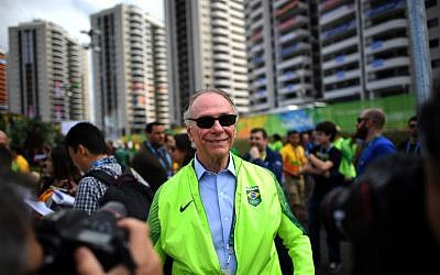 This file photo taken on July 31, 2016, shows Carlos Arthur Nuzman, president of the Rio 2016 Organizing Committee, attending the welcome ceremony for Brazil's Olympic team at the Olympic Village in Rio de Janeiro. (AFP Photo/Johannes Eisele)