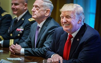 US President Donald Trump smiles as Defense Secretary James Mattis (C) looks on during a meeting with senior military leaders at the White House on October 5, 2017.(AFP Photo/Mandel Ngan)