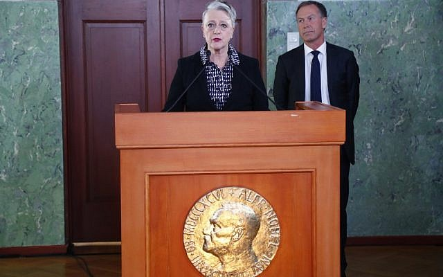 The chairwoman of the Norwegian Nobel Committee Berit Reiss-Andersen, announces on October 06, 2017 in Oslo, that the 2017 Nobel Peace Prize goes to the nuclear disarmament group ICAN for its decade-long campaign to rid the world of the atomic bomb as nuclear-fuelled crises swirl over North Korea and Iran. (AFP PHOTO / NTB Scanpix / Heiko JUNGE )