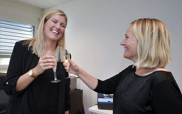Nuclear disarmament group ICAN executive director Beatrice Fihn (L) and member of the steering committee Grethe Ostern celebrate with champagne after ICAN won the Nobel Peace Prize for its decade-long campaign to rid the world of the atomic bomb as nuclear-fueled crises swirl over North Korea and Iran, on October 6, 2017 in Geneva. (AFP/Fabrice Coffrini)