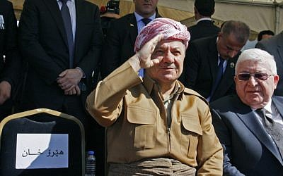 Iraqi Kurdish leader Massoud Barzani (L) sits next to Iraqi President Fuad Massum during a funeral ceremony at the airport in the Iraqi Kurdish city of Sulaimaniyah for ex-president Jalal Talabani, on October 6, 2017. (AFP Photo/Shwan Mohammed)