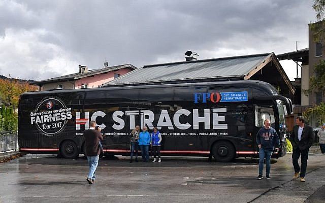 Supporters pose for pictures in front of the campaign bus of the chairman of the far-right Freedom Party of Austria (FPOe) during one of his campaign meetings ahead of snap elections, October 6, 2017, in Saalfelden. (AFP/WILDBILD)
