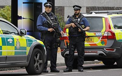 Illustrative: Armed police officers on duty in London, at the junction of Exhibition Road and Cromwell Road, between the Victoria and Albert Museum and the Natural History Museum, October 7, 2017. (AFP/Tolga Akmen)