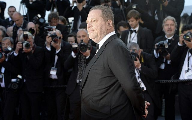 "This file photo taken on May 24, 2013 shows US producer Harvey Weinstein posing on May 24, 2013 as he arrives for the screening of the film ""The Immigrant"" in Cannes. (AFP/ANNE-CHRISTINE POUJOULAT)"