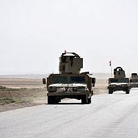 Illustrative: Iraqi army reinforcements drive down a road, linking Hawija to Kirkuk, near the village of Khabbaz on October 7, 2017. (AFP PHOTO / Marwan IBRAHIM)