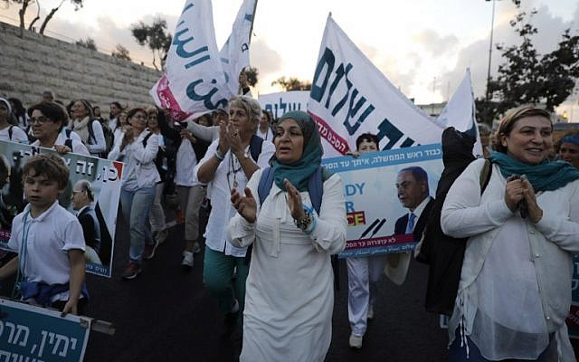Israeli and Palestinian activists of the Women Wage Peace movement march in the heart of Jerusalem on October 8, 2017. (MENAHEM KAHANA / AFP)