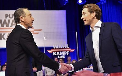 Chancellor of Austria and chairman of the Social Democratic Party of Austria (SPOe), Christian Kern (L) shakes hands with Minister for Foreign Affairs and chairman of the Austrian People's Party (OeVP), Sebastian Kurz (R), upon their arrival on a set of Austrian Plus 4 TV, October 8, 2017 in Vienna. (AFP PHOTO / APA / HERBERT NEUBAUER)