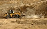 Bulldozers dig at the ancient Tell es-Sakan hill, south of Gaza City, October 9, 2017. (AFP/MAHMUD HAMS)