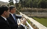 Donald Blome (L), US Consul General in Jerusalem, is seen during the launch of a conservation project to preserve the Solomon's Pools as he visits the site in the West Bank town of Bethlehem, on October 10, 2017. (AFP PHOTO/Musa AL SHAER)