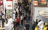 Visitors are pictured at the Frankfurt Book Fair 2017 in Frankfurt am Main, Germany, on October 11, 2017. (AFP/Amelie QUERFURTH)