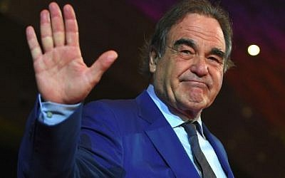 Oscar-winning US filmmaker Oliver Stone poses on the red carpet during the opening ceremony of the 22nd Busan International Film Festival (BIFF) at the Busan Cinema Center in Busan on October 12, 2017. (AFP PHOTO / JUNG Yeon-Je)
