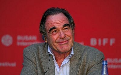 US director Oliver Stone smiles during a press conference of the New Currents Jury for the 22nd Busan International Film Festival (BIFF) at the Busan Cinema Center in Busan on October 13, 2017. (AFP PHOTO / JUNG Yeon-Je)
