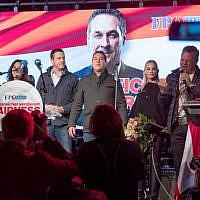 Illustrative: Leader of the right-wing Austrian Freedom Party (FPOe) Heinz-Christian Strache (C) stands next to his wife Philippa Beck and FPOe members Norbert Hofer (L) and Johann Gudenus (3rdL) at the end of a campaign event for the country's parliamentary elections on October 13, 2017 in Vienna. (AFP Photo/Joe Klamar)
