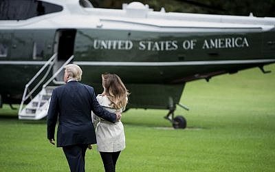 "US President Donald Trump and first lady Melania Trump walk to Marine One on the South Lawn of the White House in Washington, DC, on October 13, 2017. Trump earlier on October 13 in a highly-anticipated address refused to certify the 2015 Iranian nuclear deal, and warned the United States may yet walk away from ""one of the worst"" agreements in history.( AFP PHOTO / Brendan Smialowski)"