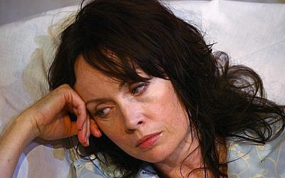 This file photo taken on September 24, 2009 shows British actress Lysette Anthony  during a rehearsal for a Tennessee Williams play entitled 'Talk To Me Like The Rain'  at the New End theatre, Hampstead, North London, England. (AFP/ MAX NASH)