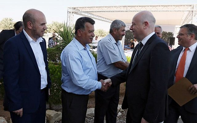US special envoy Jason Greenblatt (R) attends the launch of a project to improve access to wastewater treatment and water for Palestinian farmers, on October 15, 2017, in the city of Jericho, in the West Bank. (AFP PHOTO/JAAFAR ASHTIYEH)
