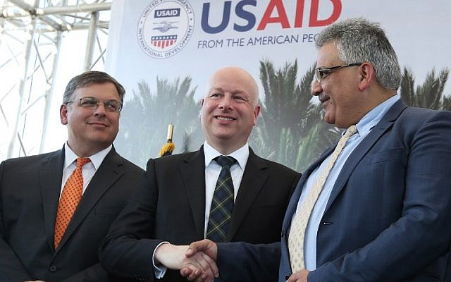 File: US special envoy Jason Greenblatt (C) shakes hands with Palestinian Water Authority chairman Mazen Ghunaim during the launch of a project to improve access to wastewater treatment and water for Palestinian farmers, on October 15, 2017, in the city of Jericho, in the West Bank. (AFP/Jaafar Ashtiyeh)