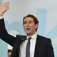 Austria's Foreign Minister and leader of Austria's center-right People's Party (OeVP) Sebastian Kurz waves to supporters during the party's election event following the general elections in Vienna, Austria, on October 15, 2017.  (AFP/ APA / ROBERT JAEGER)