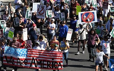 People march as they participate in the '#NoMuslimBanEver' rally in downtown Los Angeles, California on October 15, 2017. (AFP PHOTO / Mark RALSTON)