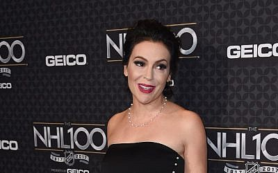 This photo taken on January 27, 2017, shows actress Alyssa Milano at a red carpet event in Los Angeles, California. (AFP Photo/Chris Delmas)
