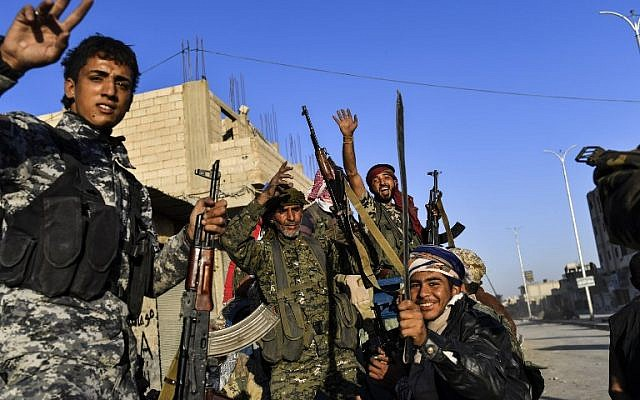Members of the Syrian Democratic Forces, backed by US special forces, celebrate at the frontline in the Islamic State group jihadists crumbling stronghold of Raqqa, October 16, 2017. (AFP/BULENT KILIC)