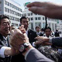 Japan's Prime Minister and ruling Liberal Democratic Party (LDP) president Shinzo Abe greets supporters during an election campaign appearance in Saitama, October 18, 2017. (AFP Photo/Behrouz Mehri)