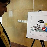 An Iranian man looks at an illustration during the 'Persian Gulf Forever' cartoon exhibition in Tehran on October 18, 2017. (AFP/STR)