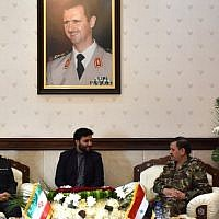 Syrian Defense Minister General Fahd al-Freij (R) meets with Chief of Staff of Iran's armed forces, Major General Mohammad Bagheri (L), at the ministry of defense in the capital Damascus on October 18, 2017. (AFP PHOTO / STRINGER)