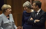 German Chancellor Angela Merkel, left, Britain Prime minister Theresa May, center, and French President Emmanuel Macron talk as they arrive in Brussels, on October 19, 2017.(AFP/JOHN THYS)
