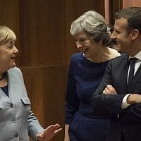 German Chancellor Angela Merkel, left, Britain Prime minister Theresa May, center, and French President Emmanuel Macron talk as they arrive in Brussels, on October 19, 2017. (AFP/John Thys)