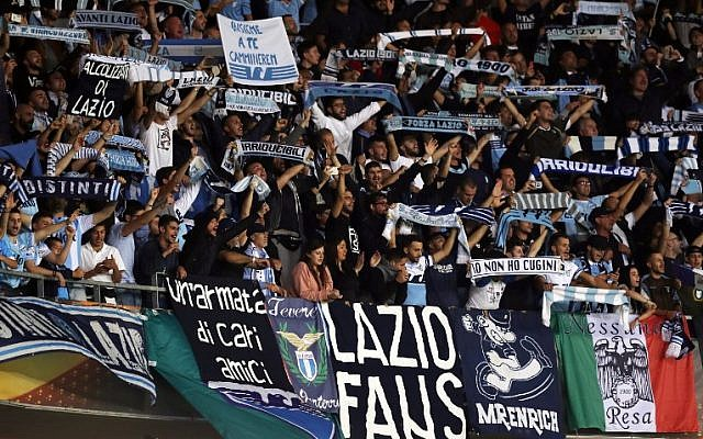 Lazio's supporters celebrate their team's victory at the end of the UEFA Europa League football match between Nice and Lazio on October 19, 2017, at the Allianz Riviera stadium in Nice, southeastern France. (AFP PHOTO / VALERY HACHE)