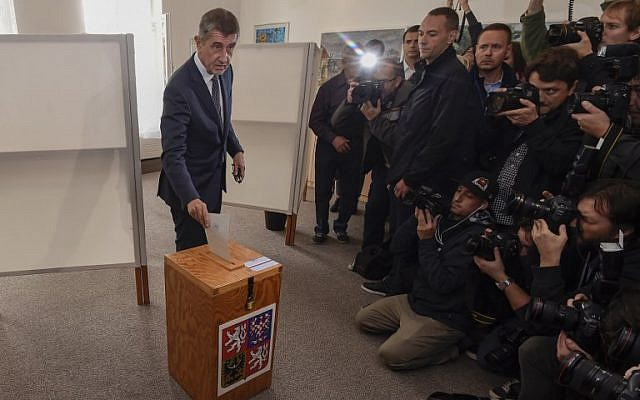 Czech billionaire Andrej Babis, chairman of the ANO movement (YES), casts his ballot at a polling station during the first day of the Czech elections on October 20, 2017 in Pruhonice, Central Bohemia. (AFP PHOTO / MICHAL CIZEK)