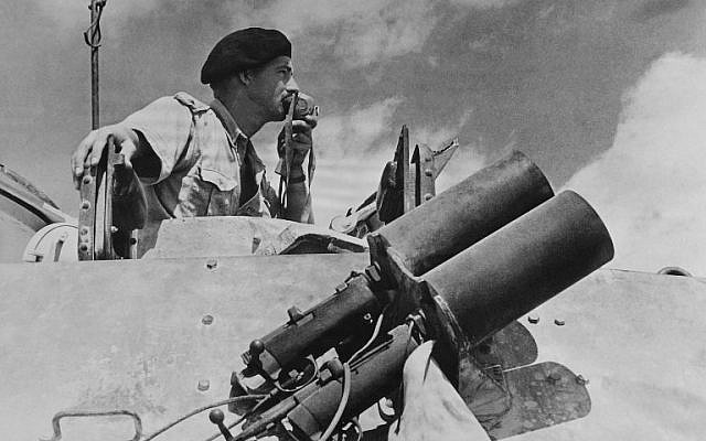 Commander of the Commonwealth and Allied forces gives instructions to tanks, in 1942 on the battlefield at El Alamein, about 60 miles (100 kilometers) west of Alexandria. (AFP)