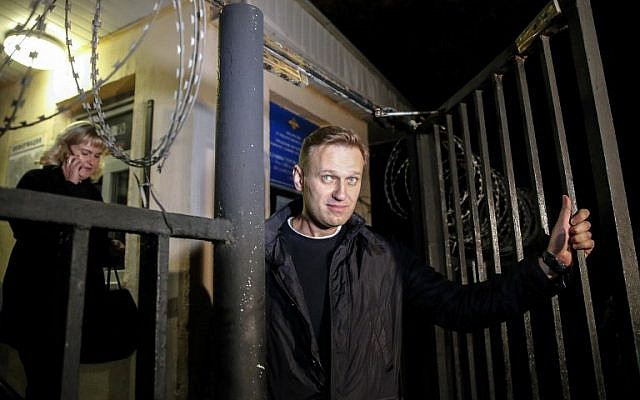 This file photo taken on September 29, 2017, shows Russian opposition leader Alexei Navalny leaving a police station in Moscow. (AFP Photo/Maxim Zmeyev)