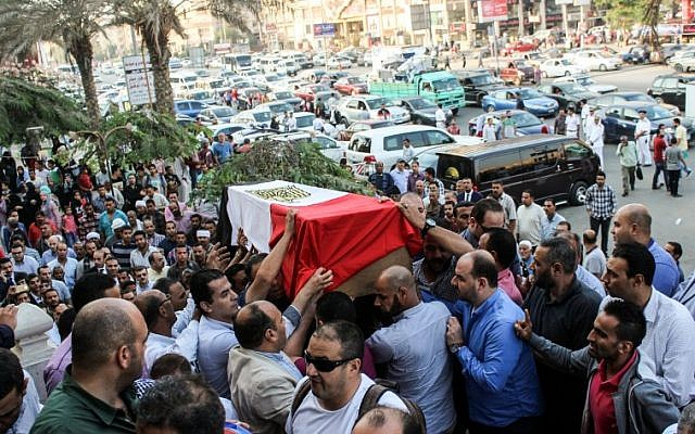 Egyptians carry the coffin of Police Cpt. Ahmed Fayez during his funeral outside a mosque in the capital Cairo's western suburb of Sixth of October, on October 21, 2017.  (Fayed El-Geziry/AFP)