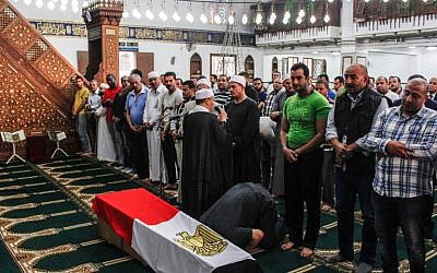 Egyptians pray before the coffin of Police Cpt. Ahmed Fayez during his funeral inside a mosque in the capital Cairo's western suburb of Sixth of October, on October 21, 2017. (Fayed El-Geziry/AFP)