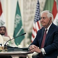 US Secretary of State Rex Tillerson listens through his earpiece to a speech translation during a meeting of the Saudi-Iraqi Bilateral Coordination Council in the capital Riyadh, October 22, 2017. (AFP/Alex Brandon)