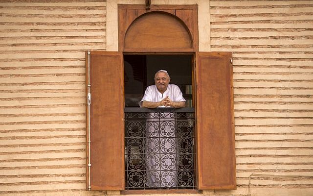 Illustrative: A Moroccan Jewish man looks out his window at the street below from his house in the 'Mellah' Jewish quarter of the Medina in Marrakesh, on October 13, 2017. (AFP PHOTO / FADEL SENNA)