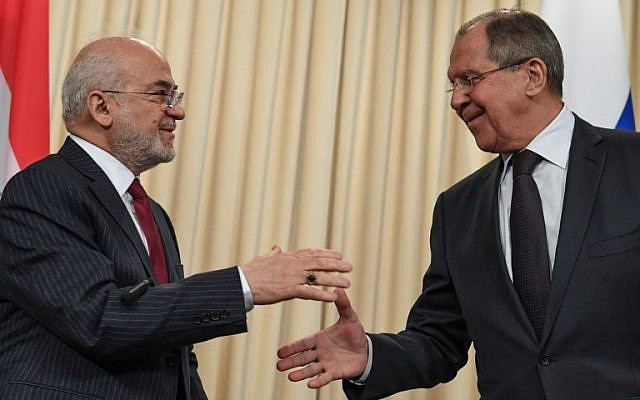 Russian Foreign Minister Sergei Lavrov, right, shakes hands with his Iraqi counterpart Ibrahim al-Jaafari at the end of a joint press conference following their meeting in Moscow on October 23, 2017 (Kirill Kudryavtsev/AFP photo)