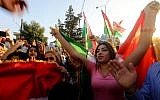 Syrian Kurds demonstrate in the northeastern Syrian city of Qamishli against Iraqi forces operation in the multi-ethnic city of Kirkuk and calling upon the international community to defend Kurdish regions in Iraq, October 23, 2017. (AFP/Delil souleiman)