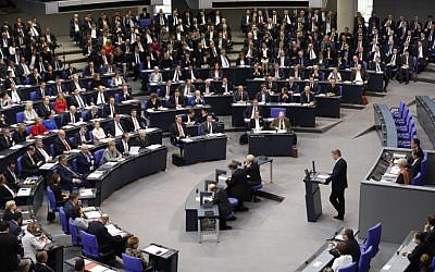 Member of the Alternative for Germany (AfD) far-right party, Bernd Baumann, the first AfD speaker in Parliament, delivers his speech during the first session of the newly elected parliament on October 24, 2017, at the Bundestag (or lower house of parliament) in Berlin. (AFP PHOTO / Odd ANDERSEN)