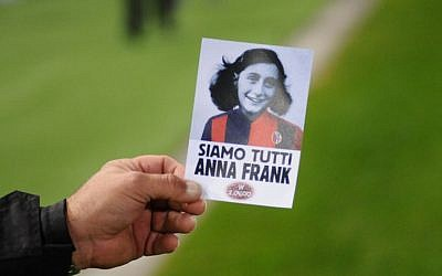 "An image of holocaust victim Anne Frank with reading ""We are all Anne Frank,"" prior the Italian Serie A football match Bologna vs Lazio on October 25, 2017 at the Renato-Dall'Ara stadium in Bologna. (AFP PHOTO / Gianni SCHICCHI)"