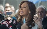 Argentina's former president and elected senator Cristina Fernandez de Kirchner speaks to reporters as she leaves the court in Buenos Aires on October 26, 2017. (AFP/Eitan Abramovich)