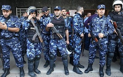Palestinian security forces stand guard outside a hospital where a senior Hamas security chief was treated after being wounded in a car bomb.  (AFP PHOTO / MOHAMMED ABED)