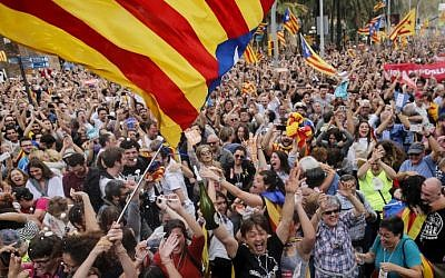 People celebrate after Catalonia's parliament voted to declare independence from Spain in Barcelona on October 27, 2017. (Pau Barrena/AFP)