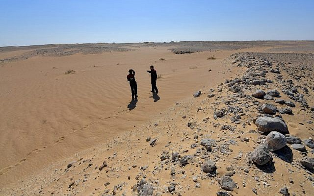 Members of the Austrian Space Forum inspect a site in Oman's Dhofar desert, near the southern Marmul outpost, on October 29, 2017, in preparation for a four-week Mars simulation mission due to begin next year. (AFP Photo/Giuseppe Cacace)