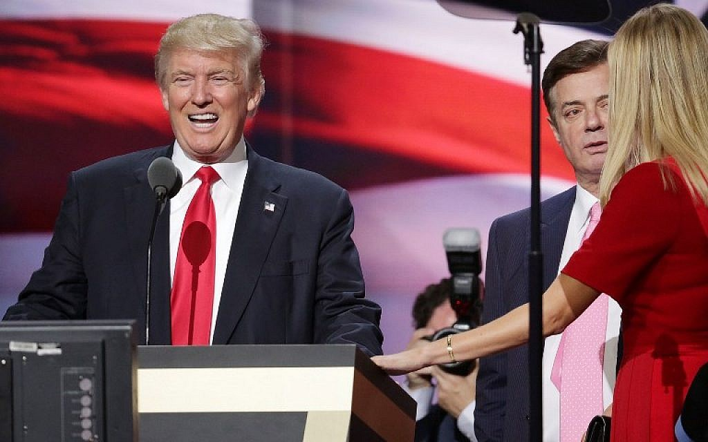 Then-Republican presidential candidate Donald Trump and his daughter Ivanka Trump, right, working with former campaign manager Paul Manafort, center, at the Republican National Convention in Cleveland, Ohio, on July 20, 2016. (Chip Somodevilla/AFP Photo)